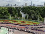 Competitors cycle past Buckingham Palace during the men's Triathlon