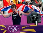Alistair Brownlee of Great Britain crosses the finish line to win Triathlon gold