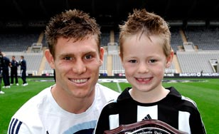 james-milner-with-youngster.jpg