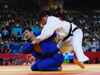 Tuvshinbayar Naidan of Mongolia competes with Tagir Khaibulaev of Russia in the men's -100 kg Judo