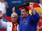 Andreas Toelzer of Germany celebrates his bronze medal