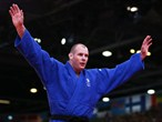 Christopher Sherrington of Great Britain celebrates in the men's +100 kg Judo