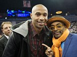 Thierry Henry and film director Spike Lee pose for a photo before the game