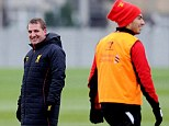 No laughing matter: Rodgers and Suarez at training on Thursday
