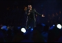 George Michael performs during the Closing Ceremony