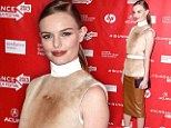 Mid-century mademoiselle: Kate Bosworth channels the '60s in bizarre 'calfskin' polo neck and white PVC boots