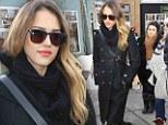 Spy style: Jessica Alba looks ready for espionage in long black coat at Sundance