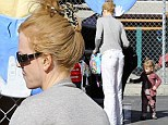 Nicole Kidman wears crumpled white trousers as she collects daughter Faith from day care after jetting back from Sundance