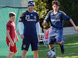 EXCLUSIVE: Brooklyn Beckham looks set to follow in father David's footballing footsteps as he is trialled for Chelsea FC