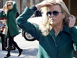 Kim Basinger stops to chat with co-star Sylvester Stallone as she makes her way to the set of Grudge Match in New Orleans
