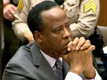 Stuck in the middle: Conrad Murray's two lawyers had a physical altercation when they visited him at LA county jail today, sources said