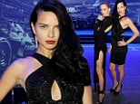 Gentlemen, start your engines! Adriana Lima and Karolina Kurkova are heavenly in little black dresses at racing event