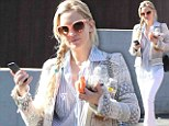 You're going to need a bigger purse: Kate Hudson has her hands full after manicure