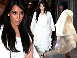 Big Bird called, he wants his feathers back! Pregnant Kim Kardashian is in full plume as she shops for more jewels with Kanye West