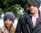 Wet weather: Ashley Tisdale and her boyfriend Chris French were seen in Hollywood on Friday
