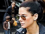 Sandra Bullock takes her little Louis to preschool on a rainy morning in Studio City
