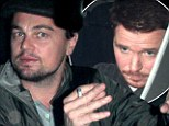Kicking the habit! Leonardo DiCaprio puffs on an electronic cigarette as he parties with Entourage star Kevin Connelly