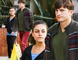 The casual couple: Mila Kunis goes without make-up for a stroll with cardigan-wearing boyfriend Ashton Kutcher