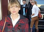 Where's your riding crop? Taylor Swift does jockey chic as she touches down in Cannes ahead of Harry Styles reunion