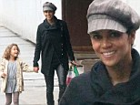 A purr-fect look! Halle Berry dons Catwoman-esque leather trousers as she picks up daughter Nahla