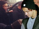 Pandemonium: Harry Styles looked sad as he arrived in Nice