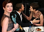 Keeping abreast of the celebrations: Anne Hathaway's husband Adam Shulman makes a boob as his wife wins Supporting Actress