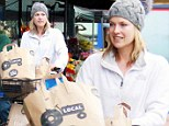 It's not the Arctic! Ali Larter goes overboard with the winter wear on a rainy day in West Hollywood