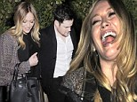 That's why she married him! Hilary Duff is left in fits of giggles after date night with husband Mike Comrie