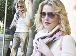 Big cover up! Katherine Heigl hides her curves in baggy trousers... as she steps out with husband Josh Kelley
