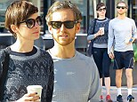 The couple that walks together, stays together: Anne Hathaway and her husband Adam Shulman take a stroll in Los Angeles