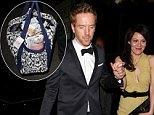 He has his hands full! Damian Lewis totes huge SAG awards goody bag as he leads his wife at after-party