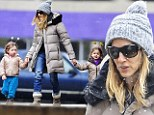 Calling all planets! Sarah Jessica Parker's twins enjoy a snowy day in matching jackets and spacey headbands