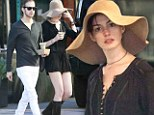 Overshadowing her rivals! Anne Hathaway celebrates SAG win by wearing lampshade style hat on coffee run