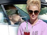 Isn't it time for a new look? Britney Spears steps out in sloppy tracksuit with a cigarette hanging out of her mouth