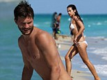 Jamie Dornan and fianceé Amelia Warner share passionate embrace as they enjoy a day at the beach