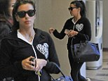 Ready to have her knots untied: Dressed down Eva Longoria welcomes a day of pampering as she steps out make-up free
