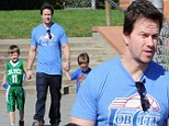Marky Mark and the bouncy bunch! Wahlberg takes his boys to basketball tournament