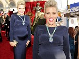 Heavily pregnant Busy Philipps shows off every curve in bewitching black gown on the SAG Awards red carpet