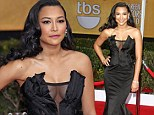 Glee star Naya Rivera turns heads in a daring low-cut gown for her red carpet entrance at the SAG Awards
