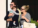 Family values: Molly Sims was seen with her husband Scott Stuber and their baby Brooks in Los Angeles