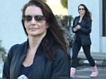 Maintaining her youthful glow: Kristin Davis, 47, displays a sore-looking red face as she emerges from Chinese health clinic