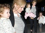 Only the best her for little jet setters: Nicole Kidman's daughters show off their silk fur lined blankets as they touch down at LAX