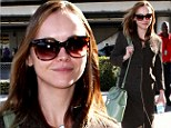 Bare faced chic! Christina Ricci goes make-up free in a smart brown coat and boots