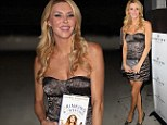 Heavy metal Housewife! Brandi Glanville displays her long legs in a very short metallic strapless dress at book launch