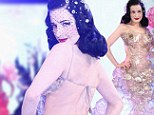 Sweet treat! Dita Von Teese dresses in clear plastic gown made entirely out of biscuit trays as she hits the catwalk