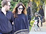 Careful! Michelle Monaghan and her husband watch nervously as their four-year-old daughter learns to ride a bike