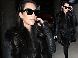 Post-holiday blues? Pregnant Kim Kardashian dresses all in black as she touches down at LAX without beau Kanye West following Parisian getaway