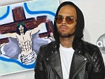 'Painting the way I feel today': Chris Brown posts Jesus crucifixion painting online after 'Frank Ocean brawl'