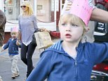 My little prince! Naomi Watts' youngest son Sammy looks regal in a pink crown as he leaves birthday party