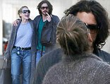 Proving the doubters wrong! Sharon Stone, 54, and toyboy beau Martin Mica, 27, share a cuddle and a smooch... a day after split reports